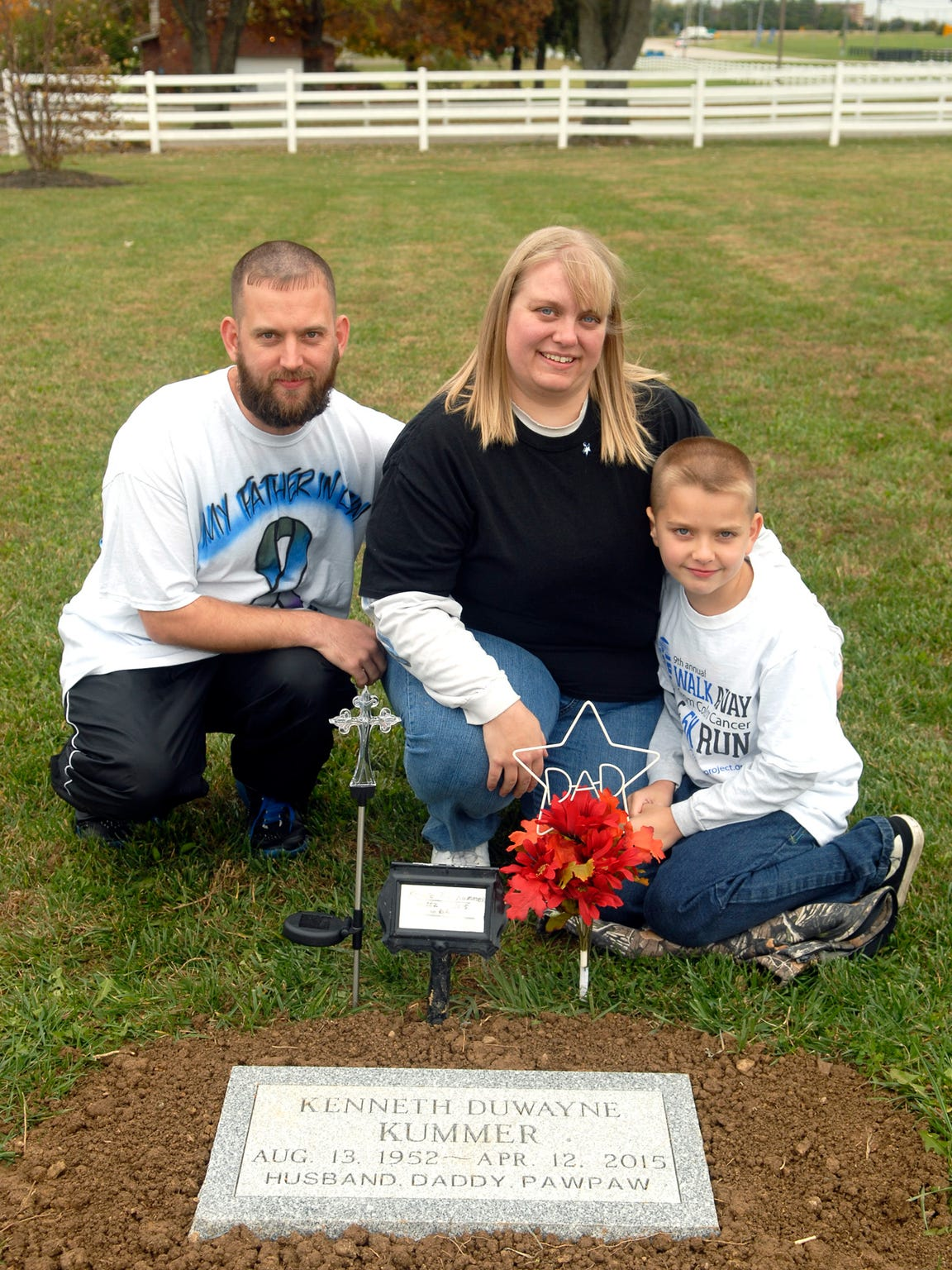 Allen and Shannon McCowan and their son, AJ, 9, pose for a portrait in front of Shannon's father's grave at Crosswater Gardens. Her father, Kenneth Kummer, died in April after an 18-month battle with colon cancer. October 31, 2015