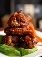 The grilled wings with Red Yeti root beer sauce at