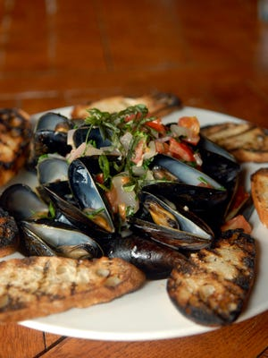 Steamed mussels with white wine cream sauce made by Chef Jeremy McFarland at Bourbons Bistro. Sept. 29, 2016