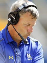 Delaware head coach Dave Brock waits for play to resume during a fourth quarter break Saturday, August 30, 2014 at Heinz Field in Pittsburgh, Pa.