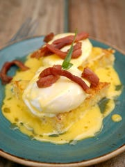 Maple eggs Benedict with soft poached eggs, grit cakes,