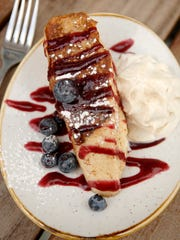 Stuffed French toast with vanilla mascarpone, cinnamon, berry jam, bourbon maple and whipped cream ($8) at Louvino's Douglas Hills Location at 11400 Main Street.