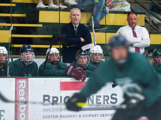 Bill O'Neil, center, watches the action from the Vermont bench during the 25th annual Make-A-Wish Hockey Classic on Saturday at Gutterson Fieldhouse. O'Neil, the longtime Essex coach, announced his retirement from high school coaching this spring after 44 years with the Hornets.