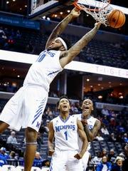 Memphis teammates Jamal Johnson, bottom left, and Kyvon
