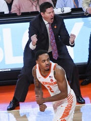 Clemson guard Marcquise Reed (2) celebrates with Clemson head coach Brad Brownell  after making a three-point shot against Miami during the second half at Littlejohn Coliseum in Clemson on Saturday.