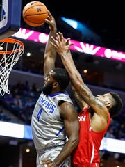 Memphis forward Raynere Thornton (left) is fouled by Houston defender Devin Davis (right) during first half action at the FedExForum in Memphis Tenn., Thursday, February 22, 2018.