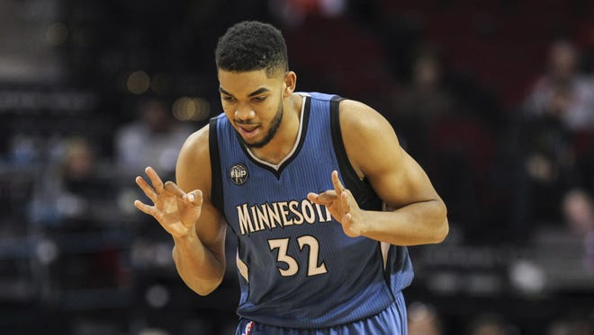 Minnesota Timberwolves center Karl-Anthony Towns (32) reacts Wednesday after making a basket during the first quarter against the Houston Rockets at Toyota Center in Houston, Texas.