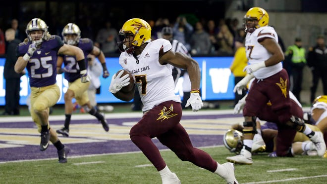 Arizona State running back Kalen Ballage (7) rushes against Washington in the second half of an NCAA college football game, Saturday, Nov. 19, 2016, in Seattle. Washington beat Arizona State 44-18.