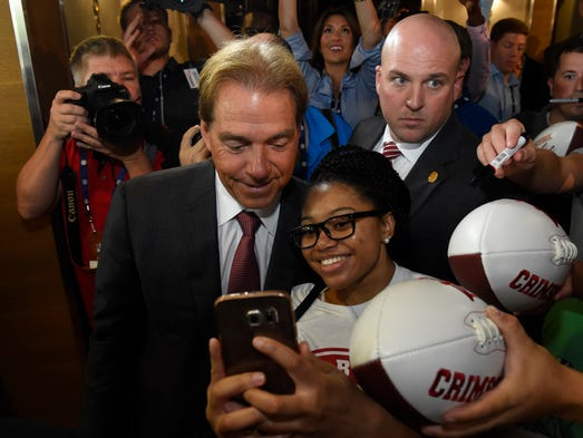 Alabama coach Nick Saban takes a selfie with fan Demeria