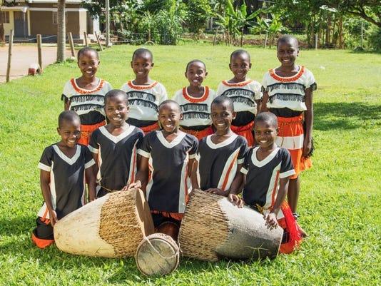 636371972429779341-AAP-AS-0813-Ugandan-choir.jpg