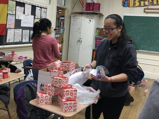 North Plainfield High School Interact Club members prepare special Valentine's Day cupcake boxes for delivery.