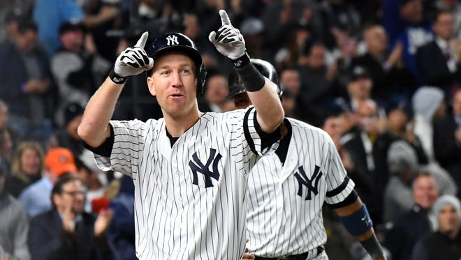 Oct 16, 2017; Bronx, NY, USA; New York Yankees third baseman Todd Frazier (29) celebrates after hitting a three run home run during the second inning against the Houston Astros during game three of the 2017 ALCS playoff baseball series at Yankee Stadium. Mandatory Credit: Robert Deutsch-USA TODAY Sports