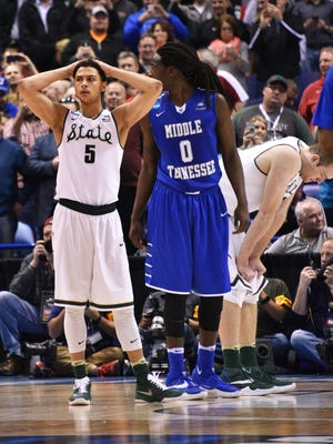 Bryn Forbes holds his head and Matt Costello bows his, as MSU falls to Middle Tennessee, 90-81.