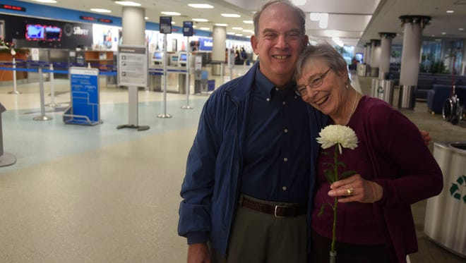 Mike and Margaret Volpe return on Sunday, Dec. 24, 2017, to the Pensacola International Airport, where the couple met exactly 50 years ago on Christmas Eve.