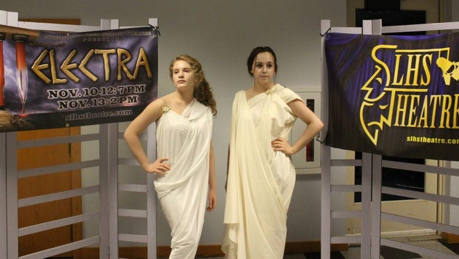 South Lyon High School Living Greek sculptures, Brooklyn Miller and Angelica Cook, at the reception.