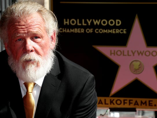 Actor Nick Nolte poses with his star on the Hollywood