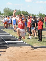 Loving's Tucker Statham catapults into the dirt in the boys long jump Monday at Eunice.