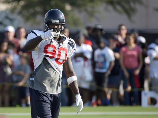 Houston Texans linebacker Jadeveon Clowney points to the sideline during an NFL football training camp practice Thursday, Aug. 14, 2014, in Houston. (AP Photo/David J. Phillip)