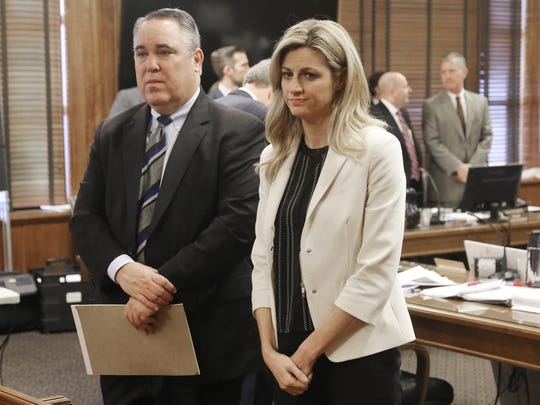 Sportscaster and television host Erin Andrews, right, stands with attorney Scott Carr as the jury enters the room during her civil trial Thursday, Feb. 25, 2016, in Nashville, Tennessee. Andrews filed and won a $75 million lawsuit against the franchise owner and manager of a luxury hotel and a man who admitted to making secret nude recordings of her in 2008.