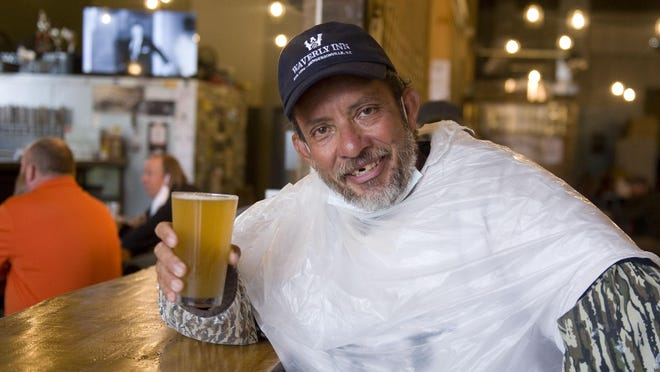 """Jose Case holds up a glass of the summer brew named in his honor, """"Lookin' Good!"""", during """"Jose Day!"""" Friday at Oklawaha Brewing Co. It was Case's birthday and he teamed up with the brewery to raise funds for local nonprofit Children and Family Resource Center, as $1 from each pint of """"Lookin' Good!"""" sold Friday went directly to CFRC."""