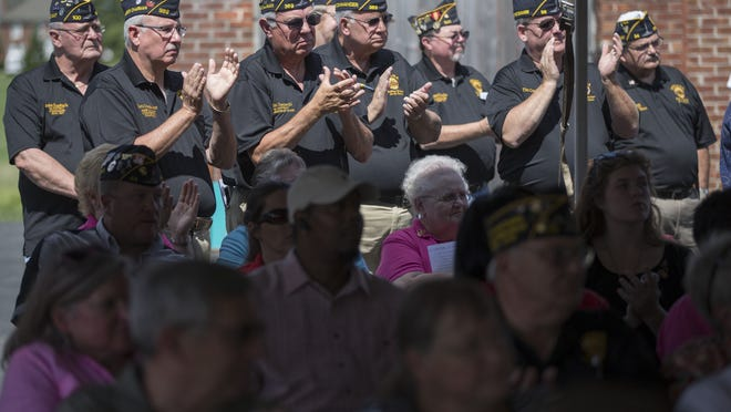 Veterans applaud during a ceremony Sept. 9, 2014, for the Indiana department of the American Legion's move from Downtown Indianapolis to the former Fort Benjamin Harrison, in Lawrence Township.