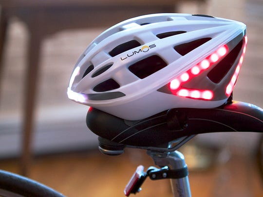 The Lumos bike helmet signals when the rider slows or turns.