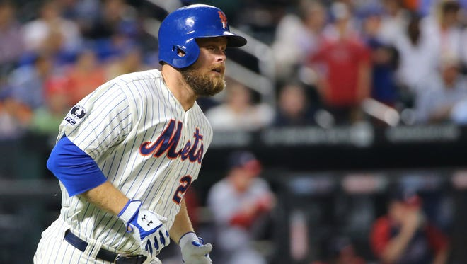 The Mets' Lucas Duda goes to first on his single to center field in the fourth inning against Washington Citi Field, on Wednesday.