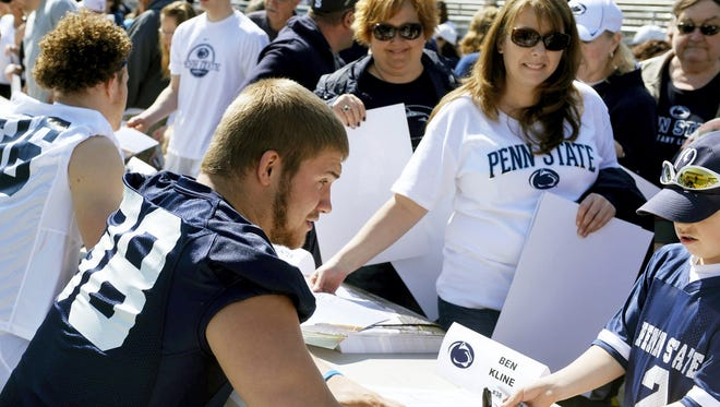 Penn State fans lined up long to get autographs from their heroes, like Dallastown's Ben Kline,  before recent Blue-White Games. University officials hope a different autograph set-up next month will help the fan flow.