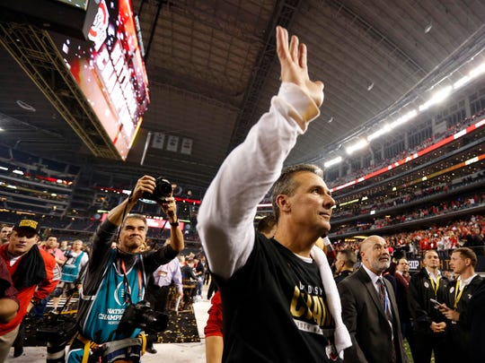 Ohio State coach Urban Meyer waves to the crowd after the national championship game.