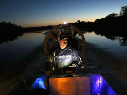 Allan Brusky steers his bowfishing vessel on Petenwell Lake in Rome, Wisconsin, May 18, 2016.