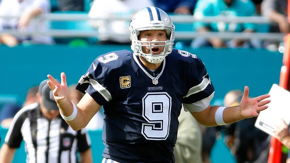 Nov 22, 2015; Miami Gardens, FL, USA; Dallas Cowboys quarterback Tony Romo (9) reacts on the field during the first half against the Miami Dolphins at Sun Life Stadium. Mandatory Credit: Steve Mitchell-USA TODAY Sports