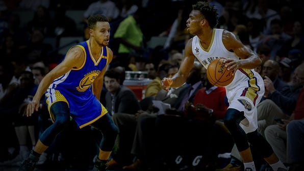 Dec 13, 2016; New Orleans, LA, USA;  New Orleans Pelicans guard Buddy Hield (24) is defended by Golden State Warriors guard Stephen Curry (30) during the first quarter of a game at the Smoothie King Center. Mandatory Credit: Derick E. Hingle-USA TODAY Sports