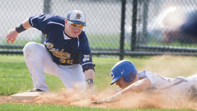 Elco's Aaron Deitz applies a tag during the Raiders' 10-5 win at Cocalico last Thursday, which clinched an L-L tournament bid.