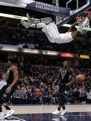 Victor Oladipo of the Pacers goes horizontal while