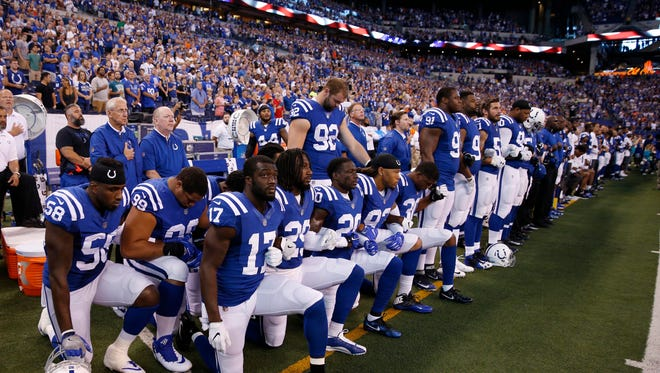 Sep 24, 2017; Indianapolis, IN, USA; Indianapolis Colts players kneel during the playing of the National Anthem before the game against the Cleveland Browns at Lucas Oil Stadium. Mandatory Credit: Brian Spurlock-USA TODAY Sports