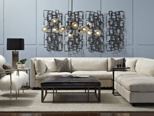 Franco Sectional with Ansel Chairs upholstered in Tibetian Shag fur - both new for Spring 2014. In addition the pendant light in brass called the Savoy is new for Spring 2014. (Courtesy Mitchell Gold + Bob Williams/MCT)