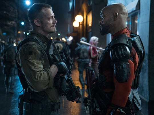 """Joel Kinnaman (left) and Will Smith in a scene from """"Suicide Squad."""""""
