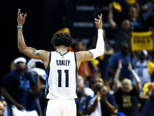 Memphis Grizzlies guard Mike Conley celebrates during