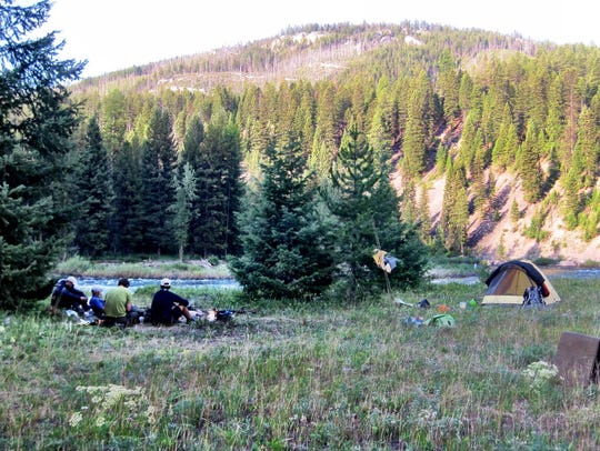 Campers prepare dinner in the Bob Marshall Wilderness.