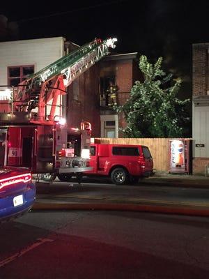 Richmond firefighters battle a blaze Wednesday morning in the 1100 block of East Main Street.
