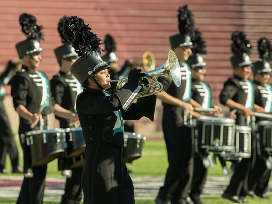 The Oñate High School band performs Saturday during the 38th annual New Mexico State University Tournament of Bands at Aggie Memorial Stadium.