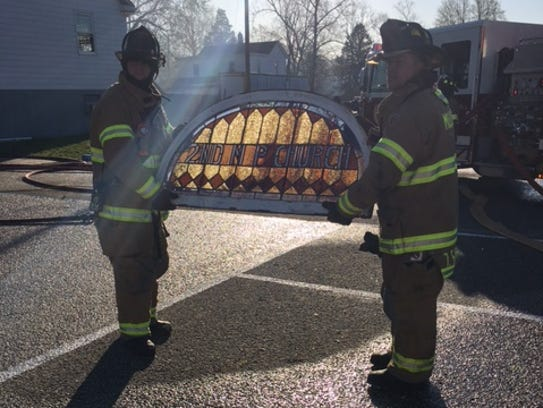 Two Millville firefighters with stained glass windows