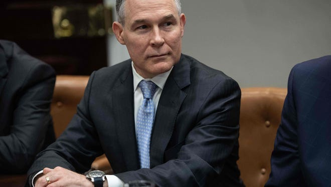 In this file photo Environmental Protection Agency (EPA) Administrator Scott Pruitt attends a meeting between US President Donald Trump and carmakers in the Roosevelt Room at the White House in Washington, DC. A woman recently confronted Pruitt at a Washington restaurant on July 2 and called on him to resign -- the latest time an official from President Donald Trump's administration has come under fire while dining out.
