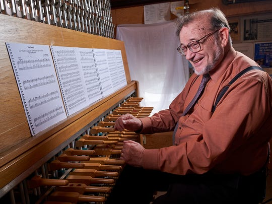 Middlebury, Vermont (June 22, 2016) - Middlebury College Carillon player George Matthew, Jr. photographed with the Mead Chapel carillon.