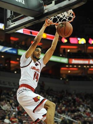 Louisville's Anas Mahmoud (14) dunks against Kentucky Wesleyan on Monday at the KFC Yum! Center. Oct. 30, 2017