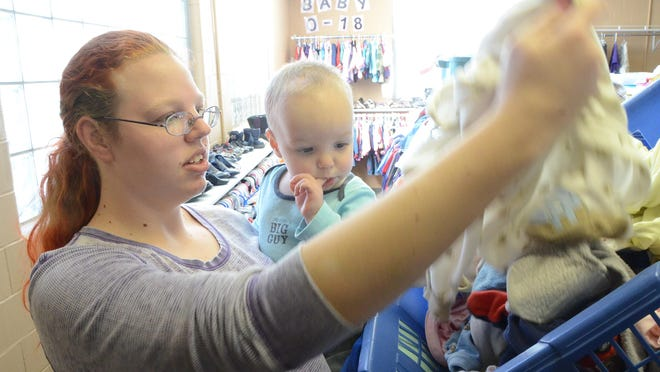 Kaitlyn Stabe and her son, 16-month-old Dominic Opdhal, shop for clothes at the Charitable Union in March 2014.