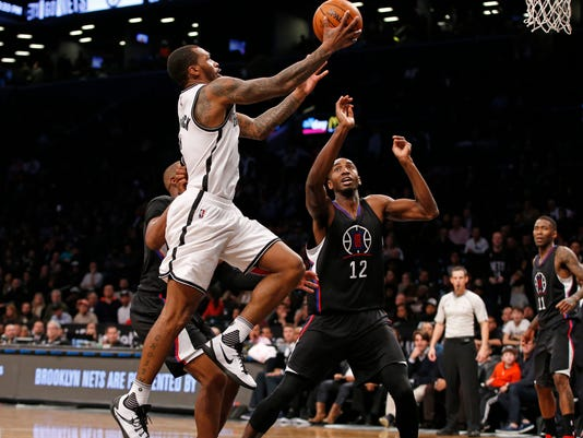 Brooklyn Nets guard Sean Kilpatrick (6) drives to the basket with Los Angeles Clippers forward Luc Richard Mbah a Moute (12) defending during overtime of an NBA basketball game, Tuesday, Nov. 29, 2016, in New York.Kilpatrick had 38 points as the Nets defeated the Clippers 127-122 in double overtime. (AP Photo/Kathy Willens)