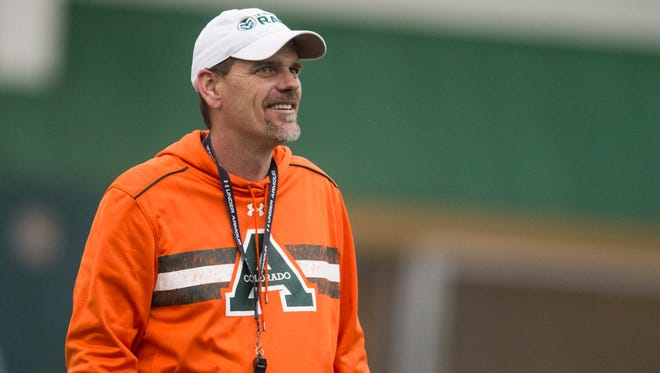 CSU coach Mike Bobo watches his team during the first practice of the year March 25.