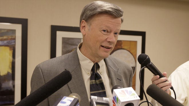 Then-State Board of Elections Chairman Larry Leake answers questions from the media after the board in 2009 ordered former the campaign of former Gov. Mike Easley campaign to pay $100,000 for failing to report campaign flights and sent Easley's case to the Wake County District Attorney's Office for a criminal review.