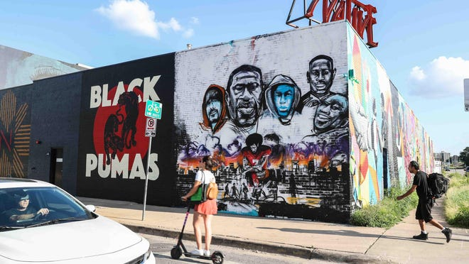 """Artist Chris Rogers painted a mural dedicated to George Floyd, Mike Ramos and others called, """"If he can't breathe, we can't breathe"""" in June 2020 at Native Hostel, a few blocks from Austin police headquarters."""